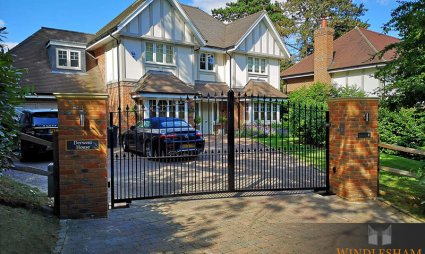 Metal Driveway Gates with Brick Piers and House Sign