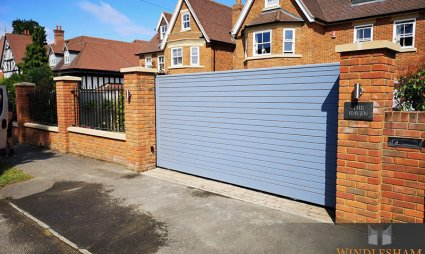 Timber Sliding Electric Gate with Brick Pillars and Lighting